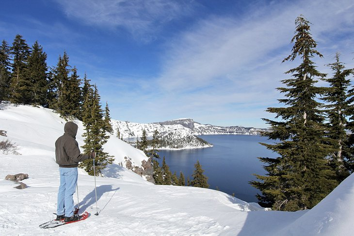 Snowshoer overlooking Crater Lake