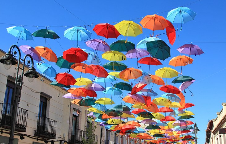 A street decorated with colorful umbrellas in Madrid
