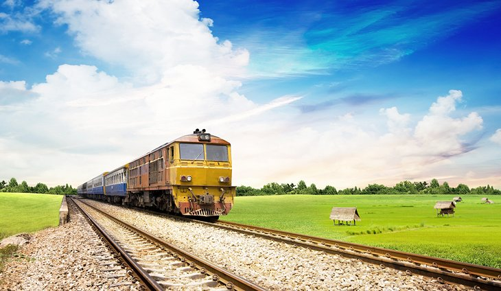 Train traveling through the Thai countryside