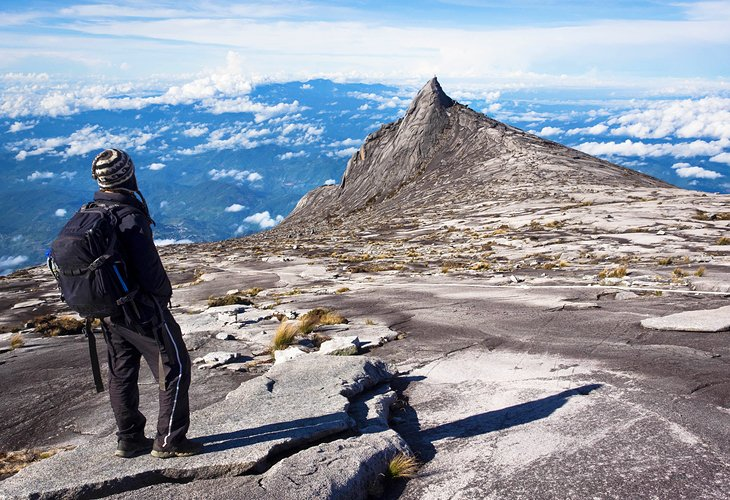 Hiker at the top of Mount Kinabalu