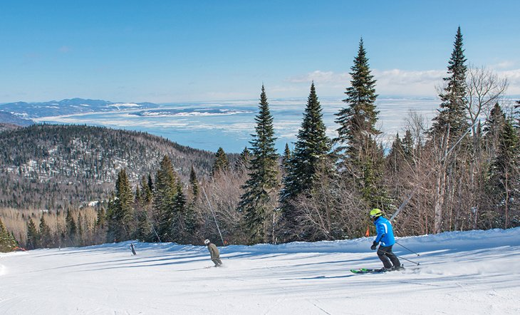 Skiing on a clear day at Le Massif
