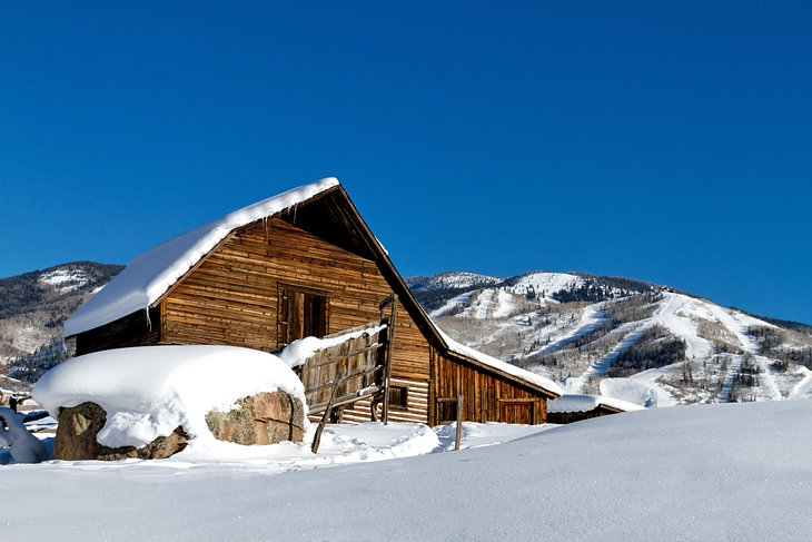 Historic Steamboat Springs barn with the ski resort in the distance