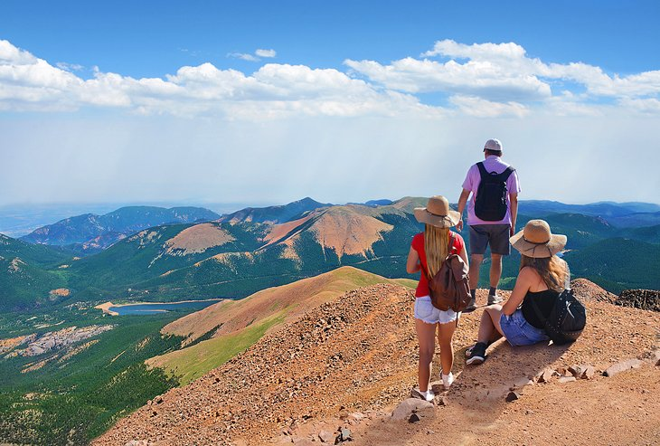 Hikers enjoying the view from the summit of Pikes Peak