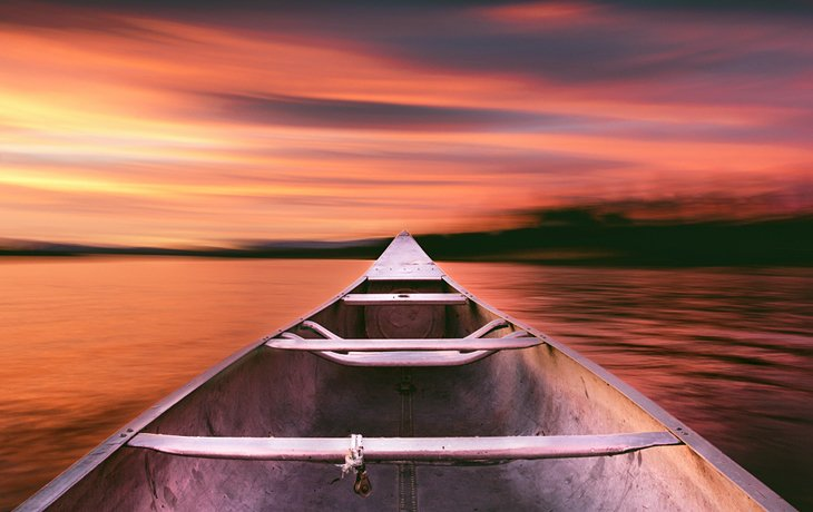 Boating on Payette Lake during sunset