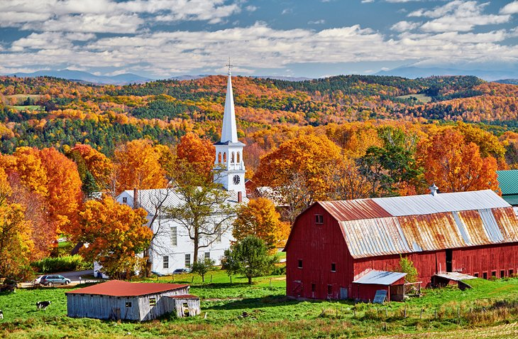 Church and farm with fall colors in Peacham, Vermont