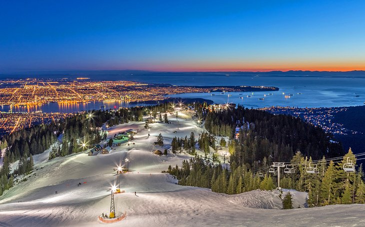 Dusk at Grouse Mountain ski resort overlooking Vancouver