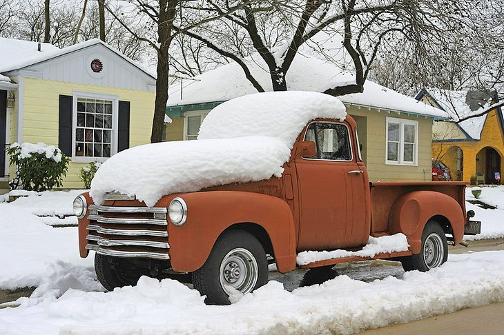Classic truck covered in snow in Fort Worth