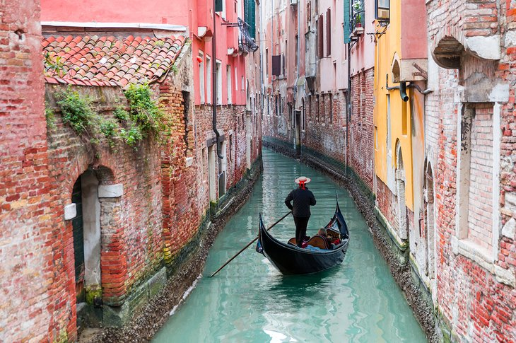 Gondolier on a canal in Venice