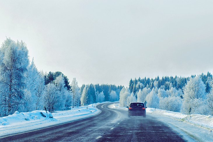 Car on winter road in Rovaniemi