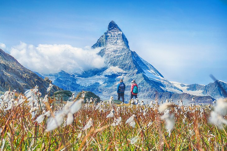 Couple hiking in front of the Matterhorn