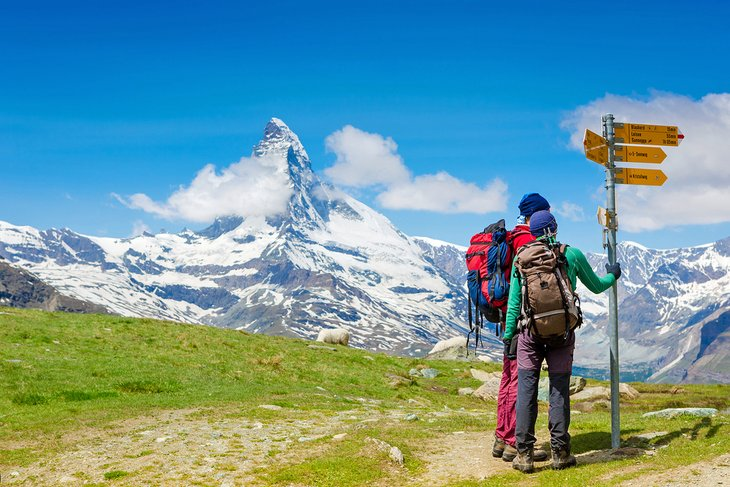Hikers in front of the Matterhorn