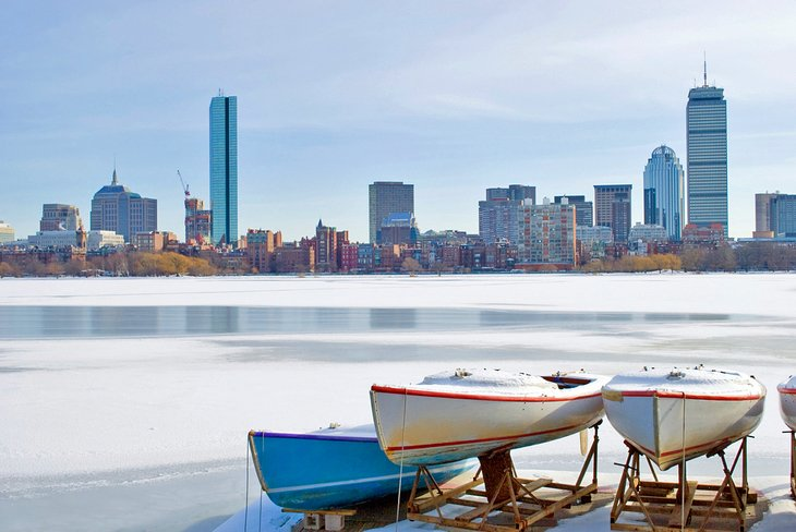 Boats on frozen Charles River overlooking the Boston skyline