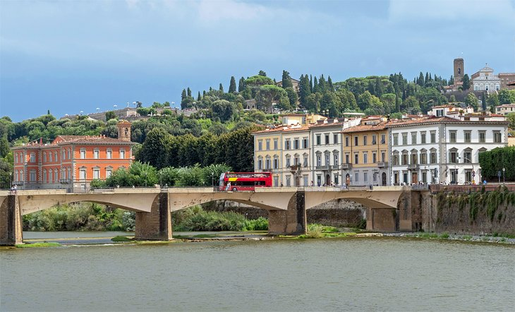 Tour bus crossing the River Arno in Florence