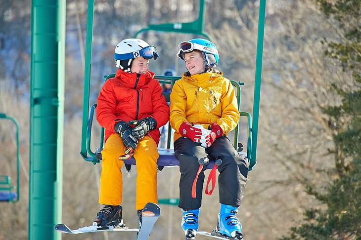 Kids enjoying the chairlift ride at Afton Alps Resort