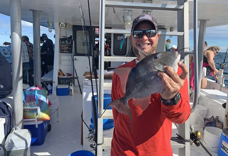 Deckhand with a triggerfish caught off Panama City Beach