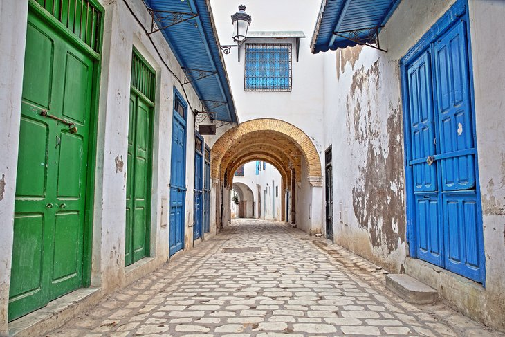 Cobblestone streets and colorful doors inside the medina of Tunis