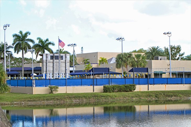 The Coral Springs Aquatic Center lies beside a lake.