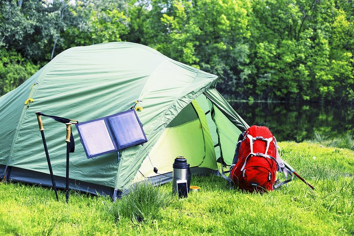 Tent with a solar panel to charge electronics